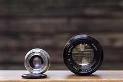 Schneider-Kreuznach Radionar 50mm F/3.5 (1951) vs Nikon 50mm F/1.4 (Arne Kuilman) Tags: lens 50mm design nikon size difference lenscap triplet comparison nikonf 50mmf14 lenses compared schneiderkreuznach fmount radionar grootte radionar50mmf35
