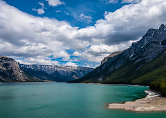 Lake Minnewanka (martincarlisle) Tags: trees sky canada mountains clouds rockies lakes parks alberta rockymountains nationalparks banffnationalpark nwn lakeminnewanka canadianrockies niksoftware olympuscameras scenicsnotjustlandscapes colourefex canadianparks