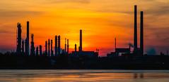 Industrial silhouette (explored) (Juergen Huettel Photography) Tags: sunset sky orange sun plant clouds fire air