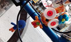 Monster Riders (Georgie_grrl) Tags: toronto ontario cute bicycle toys funny decoration cyclops monsters queenstreetwest mywhatbigeyesyouhave bikingtoronto changeyourliferideabike motog3 nicetietoo