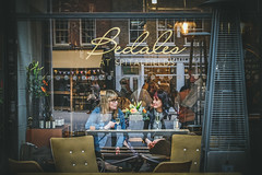 a glass of bubbly and catch up (sara.wendelmelhuish) Tags: urban london window glass reflections glasses women wine market candid relaxing streetphotography meeting bubble conversation date gossip eastend catchup prosecco spitalfieldmarket
