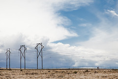 (el zopilote) Tags: people signs newmexico clouds canon landscape eos industrial wheels albuquerque bicycles powerlines roads fullframe westmesa canonef24105mmf4lisusm 5dmarkii