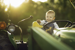 Little Man, Big Tractor (Phillip Haumesser Photography) Tags: life boy baby tractor cute love smile childhood smiling happy photography kid child farm farming working happiness littleman farmer cuteness littleboy childphotography littlefarmer