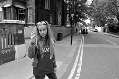 Everything In The Street Today Seems Beautiful (Steve Lundqvist) Tags: street bw white black london girl sunglasses fashion hair streetphotography teen teenager londra sporty monocrome