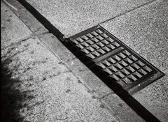 A drain among cement (Matthew Paul Argall) Tags: blackandwhite concrete 110 cement drain bleak austere 110film orcafilm halinapix110f