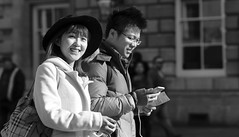 Another Smile for the Photographer (Just Ard) Tags: street people blackandwhite bw woman white black blancoynegro girl monochrome smile face person photography mono nikon eyecontact noiretblanc zwartwit candid d750 unposed  biancoenero schwarzundweis justard