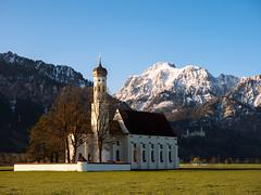 St. Coloman Schwangau (heikodreher) Tags: morning light mountain snow church st golden spring flickr olympus hour neuschwanstein omd schwangau coloman