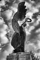 The sky over L'Aquila (Mario Ottaviani Photography) Tags: sky blackandwhite bw white black monochrome statue angel clouds monocromo sony over bn cielo angelo bianco nero cloudscape biancoenero laquila sopra sonyalpha a6000 ilce6000