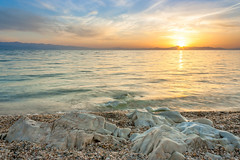 Summer Mood (Nick Panagou) Tags: longexposure light sunset sea sky sun seascape reflection nature water rock clouds contrast landscape gold sand rocks warm colours greece skyandclouds sunsetlight goldenhour cloudysky waterscape greatphotographers thessaly flickrinteresting flickrsbest flickrnature bestshotoftheday magnesia canon400d flickrbest bestphotographer naturegreece
