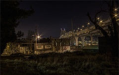 GRASSY KNOLL LOT -16478- (Terry Frederic) Tags: longexposure usa night oregon photoshop buildings portland cityscape bridges hdr fremontbridge canoneos550d canont2i terryfrederic northwestindustrialdistrict topazadjust5processed topazdenoiseprocessed lightroom60processed hdrprojects3proprocessed