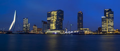 The skyline of Rotterdam. (Mark Willemse) Tags: city bridge blue water netherlands skyline lights evening rotterdam towers hour