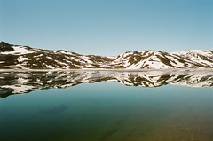 Morning Reflection (IggyRox) Tags: morning camp lake snow mountains reflection film nature water beauty norway 35mm mirror norge europe view clear edge scandinavia jotunheimen vang oppland bygdin