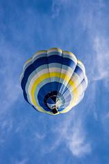 Payload (A Different Perspective) Tags: blue newzealand sky cloud yellow fiesta balloon stripe martinborough wairarapa