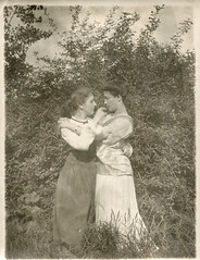 Two affectionate women embracing in a field (oakenroad) Tags: old woman white black monochrome vintage lesbian found blackwhite antique snapshot photograph vernacular affectionate interest foundphotograph embracing lesbianinterest
