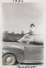 Young woman seductively posing on the roof of a car 1 (simpleinsomnia) Tags: old woman white black sexy monochrome car vintage found blackwhite antique snapshot young photograph hood vernacular seductive youngwoman foundphotograph