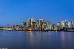Canary Wharf from Rotherhithe (Leigh Cousins RAW) Tags: london water skyline buildings reflections evening cityscape east citylights bluehour canarywharf riverthames rotherhithe londonskyline southdockmarina panpeninsula helsinkisquare