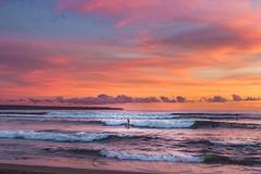 sunset surf (maikepiel) Tags: ocean travel sunset sea sky bali seascape beach nature clouds strand indonesia landscape dawn evening abend meer waves colours sonnenuntergang surfer echo himmel wolken dmmerung bunt indonesien farben wellen canggu