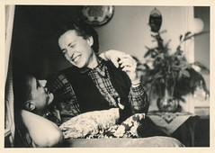 Happy couple embracing (simpleinsomnia) Tags: old woman white man black monochrome smiling vintage found blackwhite hugging couple antique interior snapshot photograph vernacular foundphotograph embracing