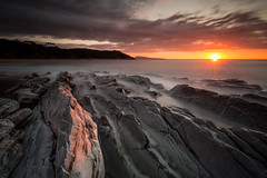 Plage de Lafitenia, Pays Basque. (Herv D.) Tags: ocean longexposure sea mer seascape france landscape soleil rocks coucher paysage pays basque poselongue flysch guethary