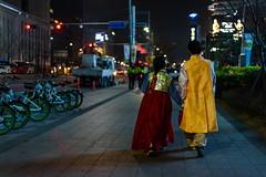 Love Is in the Air (TigerPal) Tags: street love yellow night dark couple availablelight traditional korea romance korean seoul romantic hanbok gwanghwamun