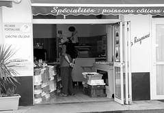 Fish shop Portsall (patrick_milan) Tags: street people blackandwhite bw white fish black monochrome shop noir noiretblanc market nb rue poisson march blanc personne streetview gens poissonerie