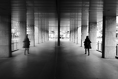 Mirrored (maekke) Tags: urban bw woman reflection architecture switzerland noiretblanc streetphotography fujifilm zrich ch 2016 x100t