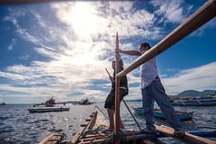 BoatMan (www.lorenzmaophotography.com) Tags: blue sea sun water clouds boats bluesky seashore boatman smallboat palakaya