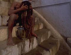 Varanasi Hair Wash (travelnotes) Tags: travel people india man male dreadlocks hair photography asia indian steps varanasi michel sadhu ganges rituals ghats seminaked abw holymen travelphotos travelnotes travelpics michelguntern