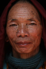 Swayambhu Monk ( Jamie Mitchell) Tags: old travel nepal portrait people man smile scarf religious happy eyes asia faces buddha stupa buddhist religion culture peaceful monk buddhism holy age portraiture kathmandu cloak nepalese mole wrinkles nepali robes swayambhu swayambhunath