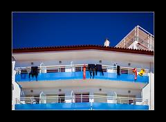 L' Estartit (tkimages2011) Tags: blue sky building spain balcony diving catalonia catalunya costabrava catalan wetsuit lestartit neoprene