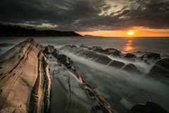 Lafitenia (Herv D.) Tags: ocean longexposure sunset sea mer seascape france landscape rocks country paysage vagues pays basque rochers pyrnes atlantique poselongue flysch guethary lafitenia wavess coucerdesoleil