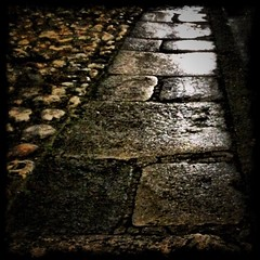 Hasty snap of a wet pavement (Caroline Oades) Tags: camera england wet night westsussex pavement sidewalk paving aftertherain afterdark chichester yorkstone enlight southpallant