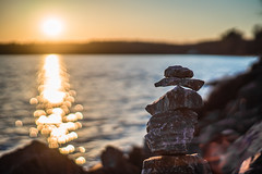 Balancing Rocks (Evan's Life Through The Lens) Tags: camera blue sunset orange sun lake cold color green beach water glass beautiful vintage lens focus friend afternoon waterfront purple minolta bright bokeh walk vibrant f14 sony side sunny front hike lakeside adventure shallow 58mm a7s