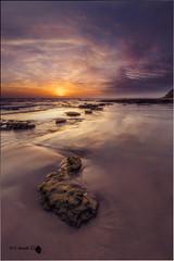 Fin del da (Caramad) Tags: longexposure light sunset sea espaa seascape marina landscape mar agua rocks playa colores andalucia puestadesol olas rocas wate cadz chiclanadelafrontera oceanoatlantico