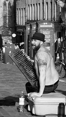 street performer 02 (byronv2) Tags: street blackandwhite bw man monochrome hat tattoo beard scotland blackwhite edinburgh candid tattoos topless royalmile streetperformer performer oldtown peoplewatching bedofnails edimbourg