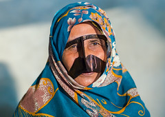 a bandari woman wearing a traditional mask called the burqa, Qeshm Island, Salakh, Iran (Eric Lafforgue) Tags: portrait people woman horizontal outdoors persian clothing asia veil mask iran muslim islam religion hijab culture persia headshot hidden covered iranian adults adultsonly oneperson traditionaldress burqa customs ethnicity middleeastern frontview persiangulf sunni qeshmisland burka chador hormozgan onewomanonly lookingatcamera burqua middleagedwoman 50sadult   1people  iro straitofhormuz  colourpicture  salakh borqe iran034i9749 boregheh