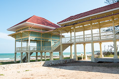 Cha-am,Phetburi-Jan21,2016:Building of Maruekhathaiyawan Palace, Huahin Chaam, Phetchaburi,Thailand on 21 January 2016 (leykladay) Tags: ocean old travel pink blue sea summer sky white house holiday building green beach home water yellow architecture thailand hotel wooden italian sand asia king royal style palace arbor thai colored verdant column sight residence bang huahin rama stilts ercole skyblue chaam manfredi phetchaburi mrigadayavan vajiravudh marukhathaiyawan