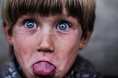 Du ciel plein les yeux (PaxaMik) Tags: blue portrait tongue kid bleu grimace freckles langue regard grosplan tirerlalangue regardbleu frenchportrait
