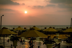 Sunsetting over Kingsbury Hotel pool (Taariq Maruzook) Tags: sunset sky pool clouds umbrella poolside colombo kingsbury kingsburyhotel