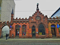 Former wine cellar and wine and tobacco store of Louis Lundmann company. Matisa Street in Riga, Latvia. March 5, 2016 (Aris Jansons) Tags: street city building statue architecture facade store europe wine capital baltic latvia tobacco riga 2016 rīga latvija cobbledstreet
