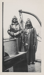 Two men in rubber rain coats at Niagara Falls (simpleinsomnia) Tags: old white black monochrome vintage found niagarafalls boat blackwhite waterfall ship antique coat snapshot tourist rubber niagara falls photograph vernacular waterproof slicker foundphotograph