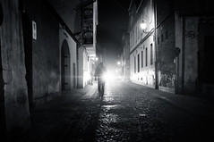 Towards the Light | Day 229 / 365 (marcin baran) Tags: street old city light shadow people urban blackandwhite bw white man black monochrome architecture night composition dark walking person town blackwhite long fuji darkness pov walk candid go poland polska going human flare fujifilm 365 element gliwice x100 365project peoplew fujix100 marcinbaran x100t