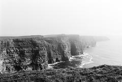 Cliffs of Moher 02 (Ian Atrus Gazzotti  iangazzotti.com) Tags: ireland blackandwhite bw cliff mist fog analog 35mm nikon cliffs bn nebbia moher biancoenero irlanda scogliere scogliera nikonf70 f70