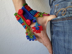 colorful beaded cuff bracelet with turquoise blue and bright red crocheted base and beaded crochet flowers in rainbow colors by irregular expressions (irregular expressions) Tags: flower jewelry bracelet wearableart bracelets cuff fiberart brightred textileart crimsonred seedbeads beadcrochet freeformcrochet crochetflower delicabeads turquoiseblue crochetbracelet beadedflowers beadedcrochet beadedbracelet crochetart beadedcuff beadedlace irregularexpressions crochetcuff fiberbracelet colorfulbracelet statementbracelet statementjewelry lacebracelet beadedcrochetcuff textilebracelet statementcuff beadedcrochetbracelet freeformcrochetbracelet beadedlacecuff
