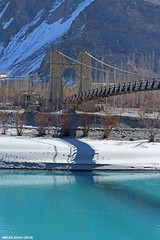 Bridge near Khaplu (gilgit2) Tags: bridge trees pakistan snow mountains ice water canon river landscape geotagged rocks structures tags location elements vegetation tele khaplu ghanche gilgitbaltistan canoneos650d imranshah canonefs55250mmf456isii gilgit2