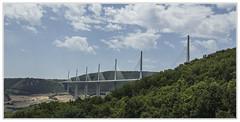Viaduc de Millau (Francis =Photography=) Tags: 2001 bridge france architecture canon structure norman viaduct foster valley infrastructure pont autoroute tarn extérieur bâtiment a75 millau viaduc aveyron vallée 2015 midipyrénées viaducdemillau 600d haubans bordurephoto