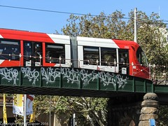 Sydney Light Rail - LRV2122 arrives at Central (john cowper) Tags: sydney newsouthwales centralrailwaystation sydneylightrail eddyavenue railwaycolonnade lrv2122