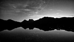 a vast cosmic arena (keith midson) Tags: mountain reflection silhouette night clouds stars evening still quiet calm tasmania wilderness dovelake cradlemountain