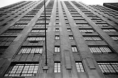 Tudor co-op on triplet lens (Patrick Copley) Tags: leica nyc newyork brick film architecture 35mm kodak leicam2 architecturalphotography converginglines trixpan casementwindows nyccoop msoptical bwfp msopticalperar tudorapartmentbuilding perar28mmf40supertriplet