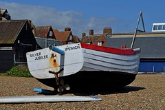 Boats at Aldeburgh (DaveJC90) Tags: camera blue light shadow sea sky blackandwhite bw cloud sun sunlight white lake black colour detail tree slr bird beach water animal digital dark lens bay boat town suffolk spring swan nikon warm colours village angle bright zoom wide sunny sharp crop 1855mm 1020mm aldeburgh thorpeness croped sharpness d5100